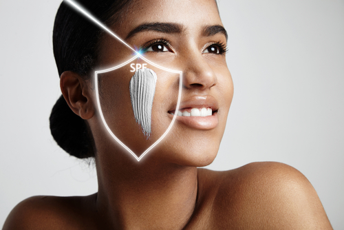 spf concept. woman with a sun protection cream on a cheek-img-blog