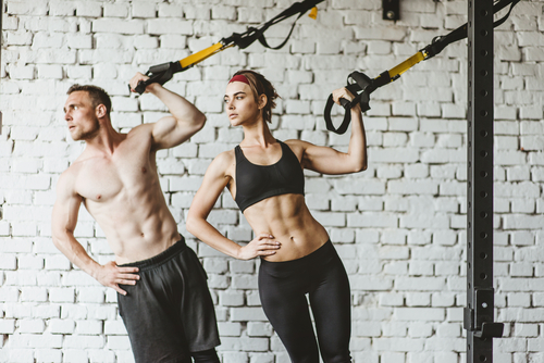 Fit man and woman exercising